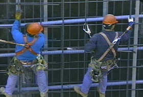 Men working on high rise